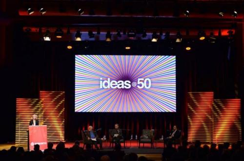 The guest speakers sit on stage at the ideas @ 50 event